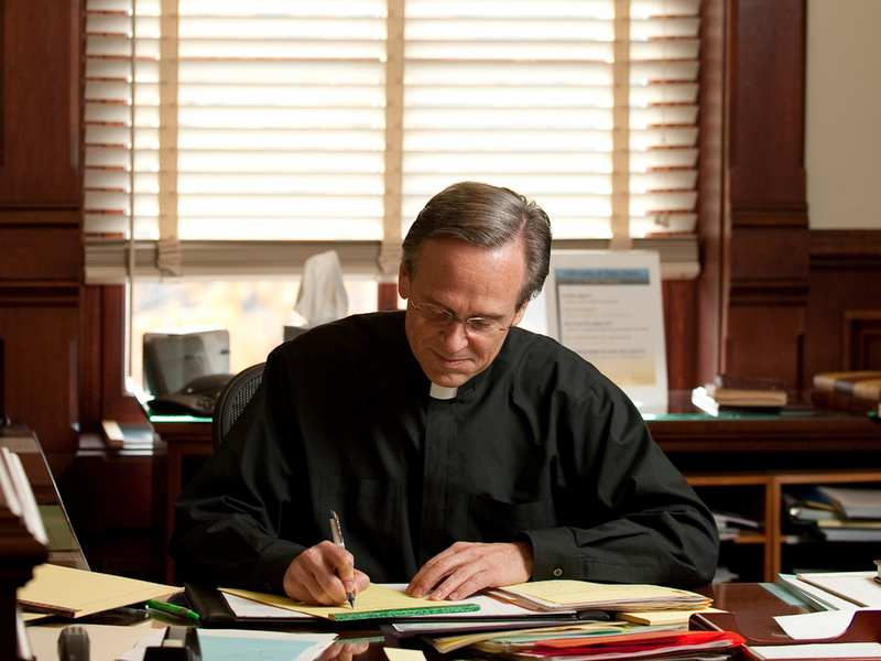 University President Rev. John Jenkins, C.S.C. in his office.