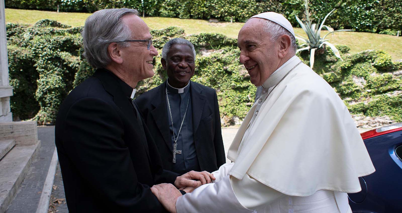 Fr. Jenkins shakes Pope Francis' hands.
