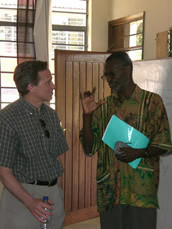 Fr John with Peter Kanyandago